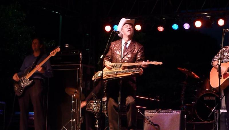 Junior Brown likes guitars so much, he put a guitar on his guitar.