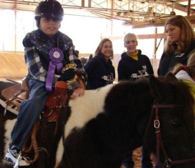 Mason Plott rides a horse at Eagles Rest Ranch.