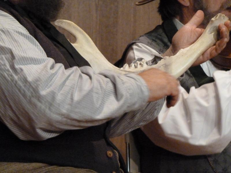 Bob Beeman uses a cow jawbone as a percussion instrument.
