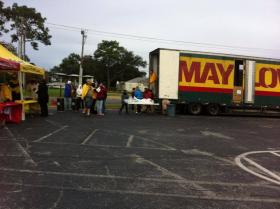 Manna volunteers work to fill the Mayflower truck in the parking lot of Cordova Mall.