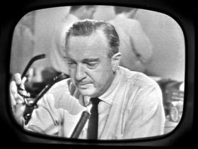 Walter Cronkite tells the nation of Kennedy's death.