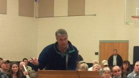 Reilly Hoggard speaks at town hall in Milton.