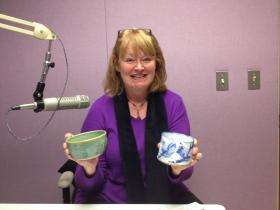 De De Flounlacker, Executive Director of Manna Food Pantries shows off a couple of the bowls available during this weekend's Fill A Bowl for Manna event.