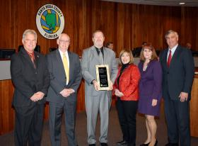"Officials from Santa Rosa County are presented with their official ""Safe Communities America"" designation. From left to right, Santa Rosa County Sheriff Wendell Hall; Jim Melvin, Board of Commissioners Chairman; Chip Fox, Chairman of Safer Santa Rosa; Donna Stein-Harris, National Safety Council;Sandra Park-O'Hara, Administrator Florida Department of Health Santa Rosa County and Tim Wrosdick, School Superintendent"