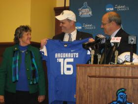 Pete Shinnick (center) is welcomed by UWF President Judy Bense and Athletic Director Dave Scott.