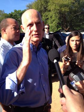 Governor Rick Scott talking to reporters on Piedmont Road in Pensacola