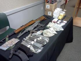 Seized heroin and weapons from Escambia County Sheriff's Office.