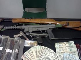 Seized cash and weapons from Escambia County Sheriff's Office.