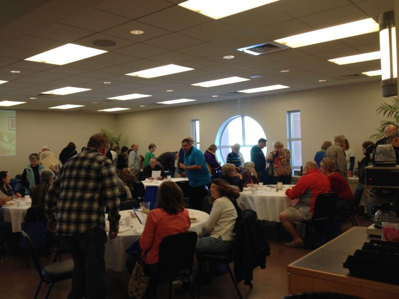 Winter visitors line up for lunch at the Pensacola Community Church for a snowbird event.
