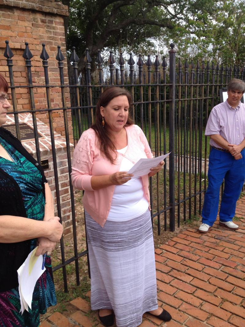 Mary Gutierrez reads the history of the chimney at the ceremony.