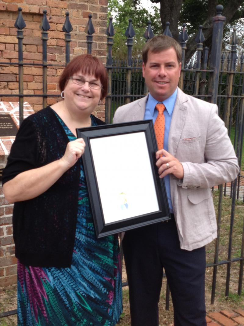 Karen Thompson, President of the Scenic Highway Foundation and Pensacola City Councilman Andy Terhaar hold the proclaimation from Mayor Ashton Hayward
