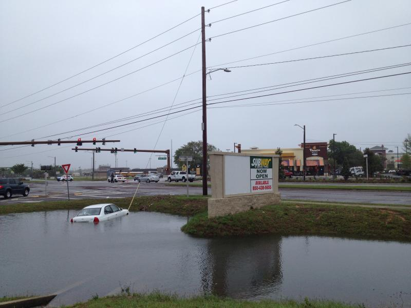 Car off the road at the corner of Daniel Dr and Gulf Breeze Parkway.