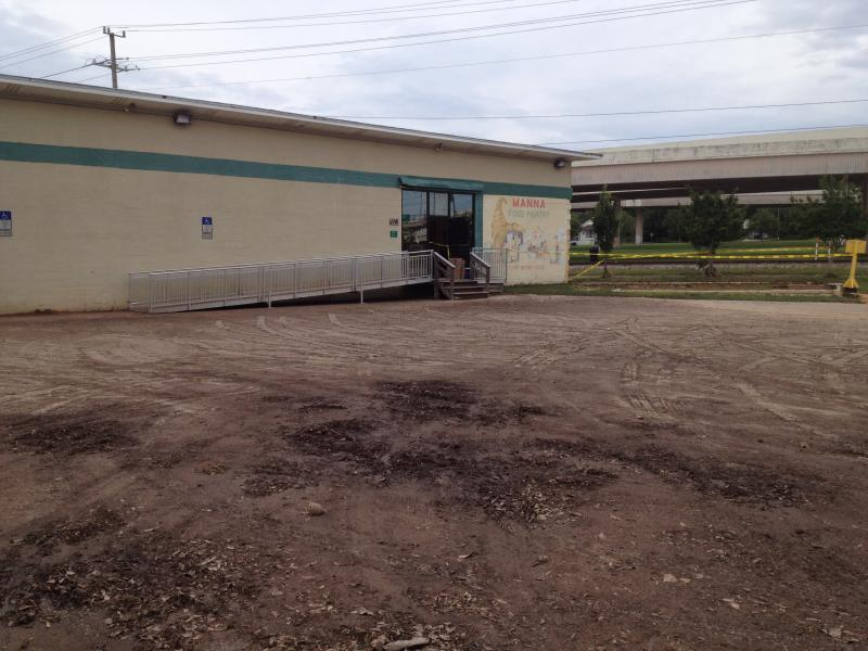 The front parking lot of Manna Food Pantry on Gonzalez Street in Pensacola is caked with mud left over from the storm.