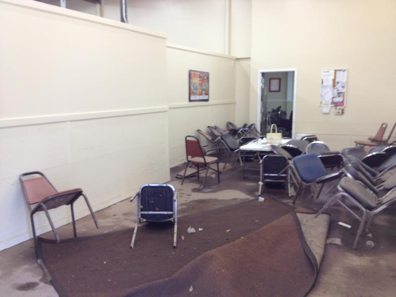 The main reception area of the Manna Food Pantry office.  Note the water line on the white wall.