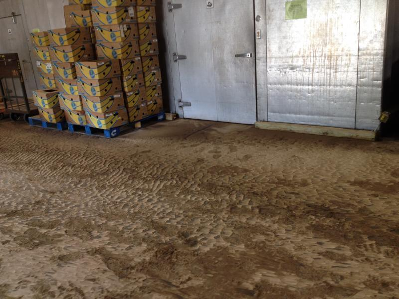 The Manna warehouse floor is also caked with mud. The water line came up to the freezer handle. All this food must be destroyed. The freezer still has a lot of standing water.