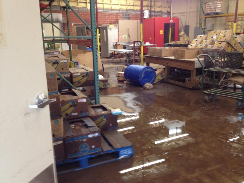 Still standing water in the office storage area.