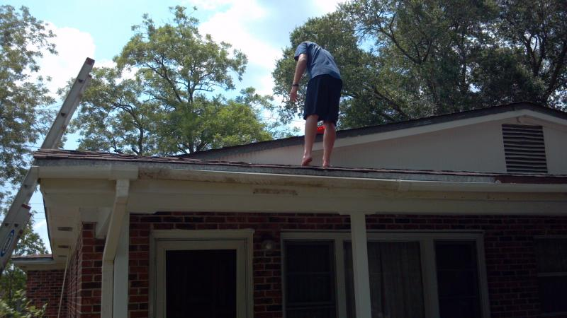 Zachery Burke, high school senior from Houston, Tx on the roof of Charles Lymons home.