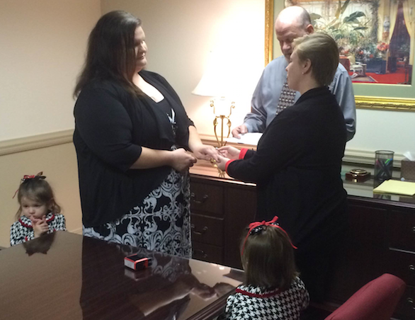 Michelle Long-Gardner (right) & Brandy Gardner (left) as they got married at Fleet And Smith P.A. in Shalimar Tuesday. Their daughters Willow, 4 and Journey, 3 are in the pics too. Bart Fleet is the one officiating the ceremony.