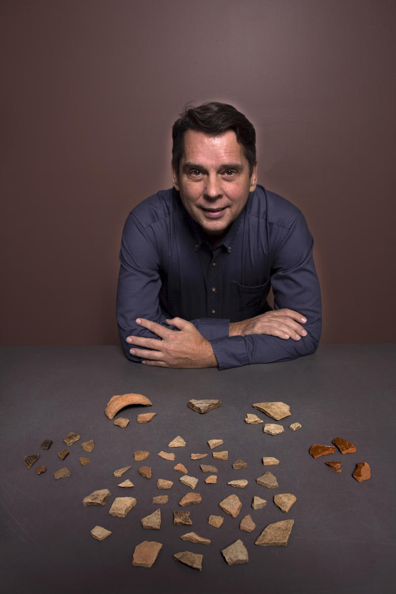 Local archeologist Tom Garner poses with some of the artifacts that confirmed the location of the first multi-year European settlement in the US
