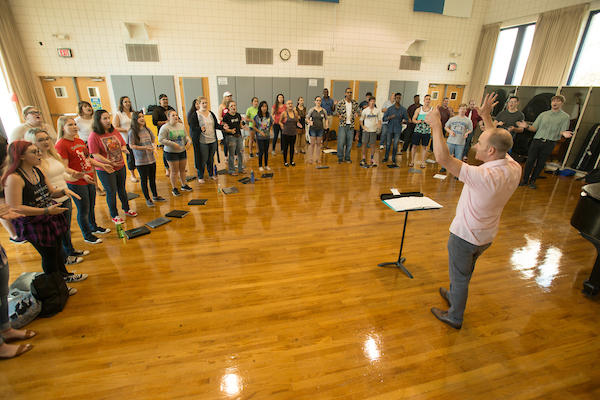 """Dr. Peter Steenblik director of choral activities rehearses the University Singers and Chamber Choir for their upcoming music presentation """"Collaborations!"""" at the University of West Florida Monday September 26, 2016 in Pensacola, Florida."""