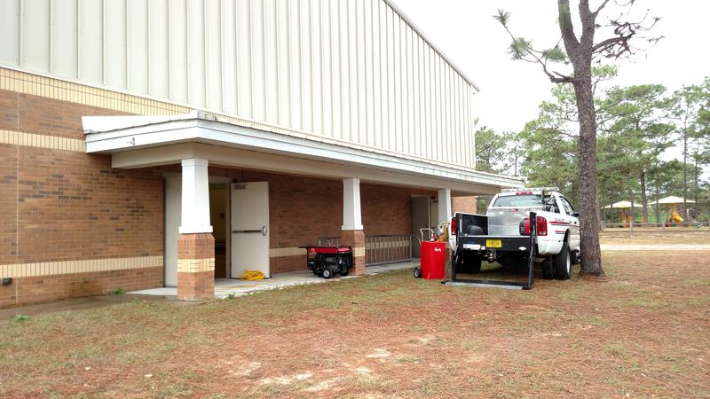 A generator provides temporary power at Escambia County's Precinct 63 in Wedgewood Community.