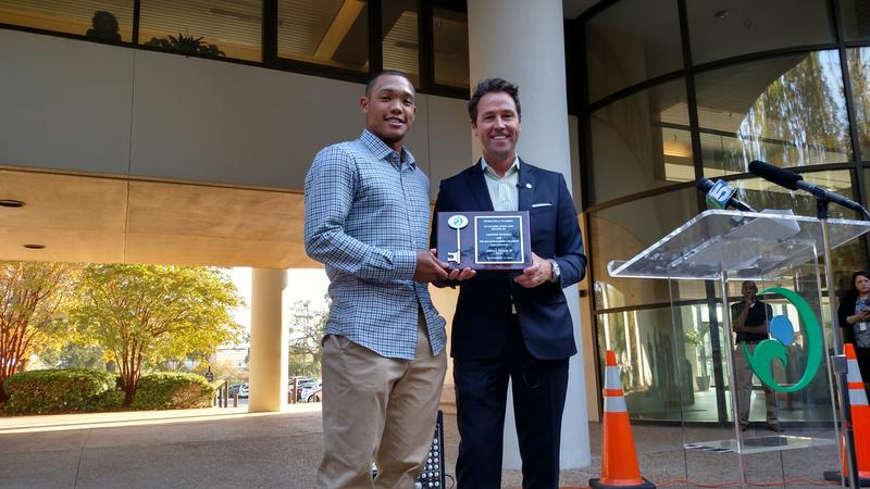 Pensacola Mayor Ashton Hayward presents Addison Russell  with a key to the city for helping the Chicago Cubs win the World Series.