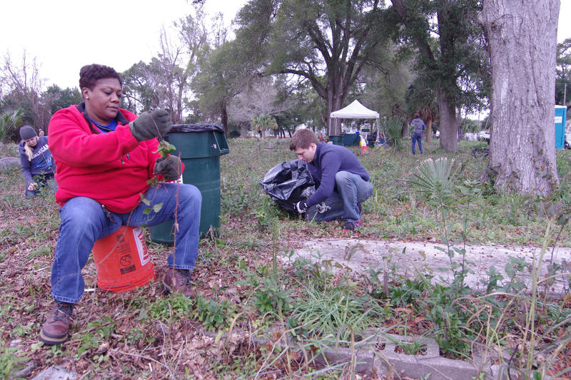 Sonja Johnson, Senior Administrative assistant, helps clean up debris last year at the Mount Zion Historic Cemetery during Gulf Power's MLK community outreach project to help clean up the area and help cultivate it for future generations. Gulf Power volun
