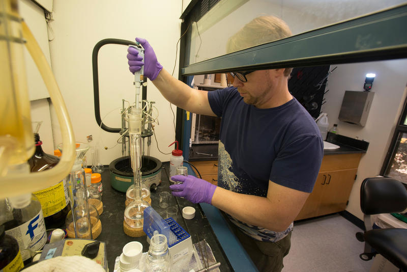 Post Doctoral research associate Geoffrey Marchal performs a soxhlet extraction at the University of West Florida Wetlands Lab Thursday December 1, 2016 in Pensacola, Florida.
