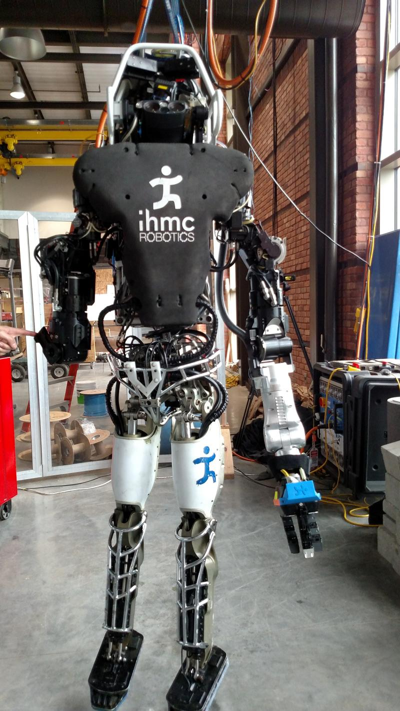 Full view of humanoid robot Atlas at the IHMC Robotics Lab.