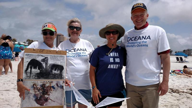 Monie Russo, Monica Parries, Margie Purkerson, and Phil Ehr take part in this year's Hands Across the Sand anti-drilling event on Pensacola Beach.