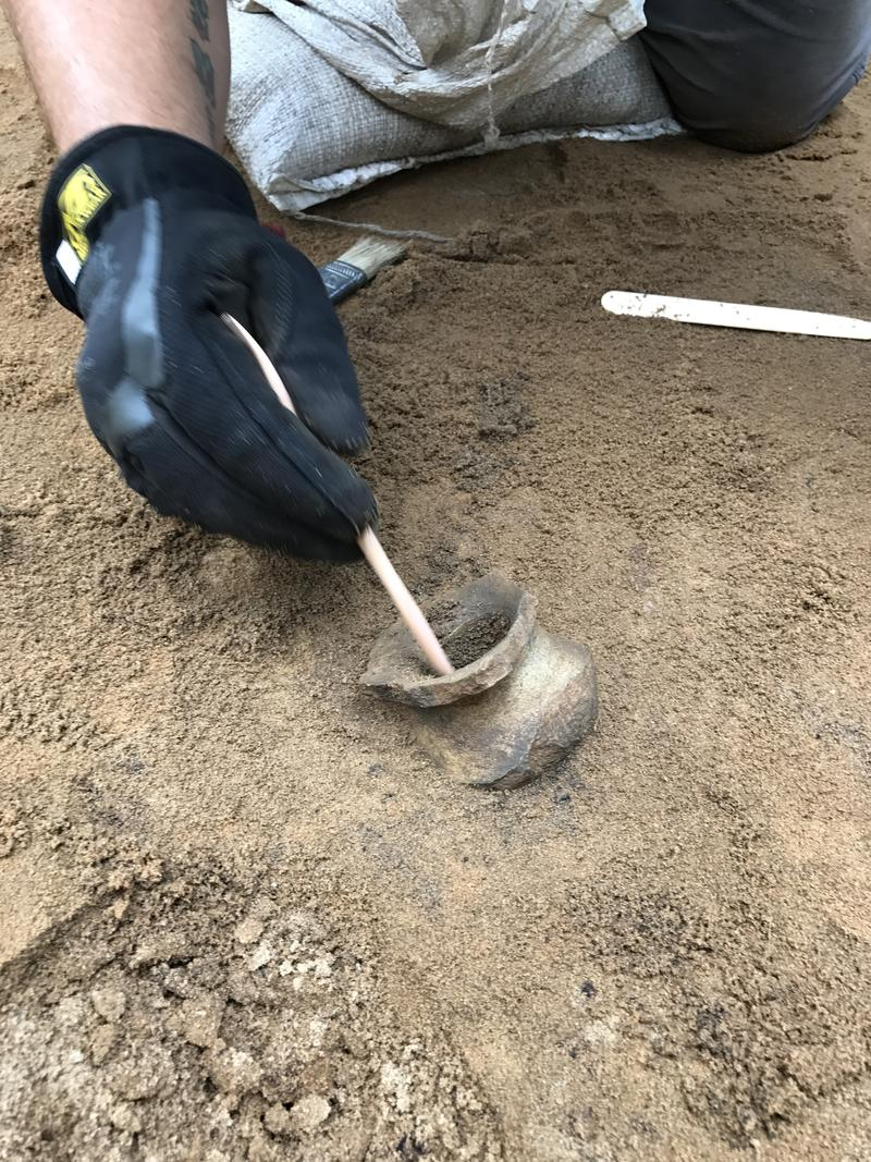 "The UWF Archaeology team uncovers first ""whole' neck and rim piece from an olive jar."