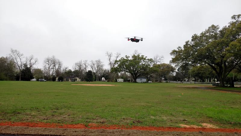 Officials from the Escambia County Extension Service fly a drone over their property on Stefani Rd.