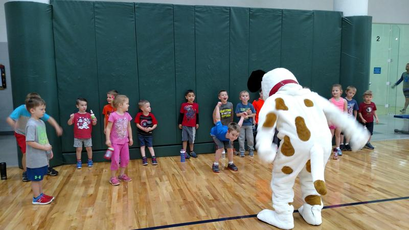 Kids line up for activities with Walker Wiggle.