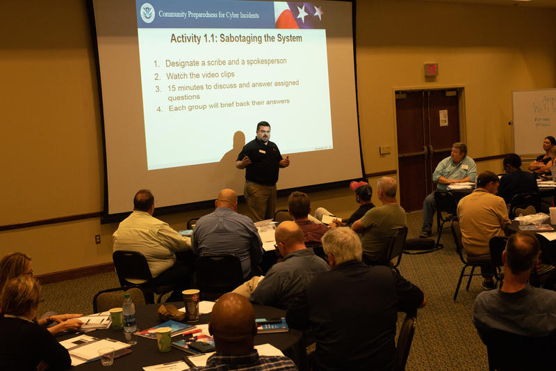 Cybersecurity instructor Michael Sevier with the Texas A&M Engineering Extension Service speaks to agencies during a cybersecurity training course Thursday May 10, 2018 at the University of West Florida in Pensacola, Florida.