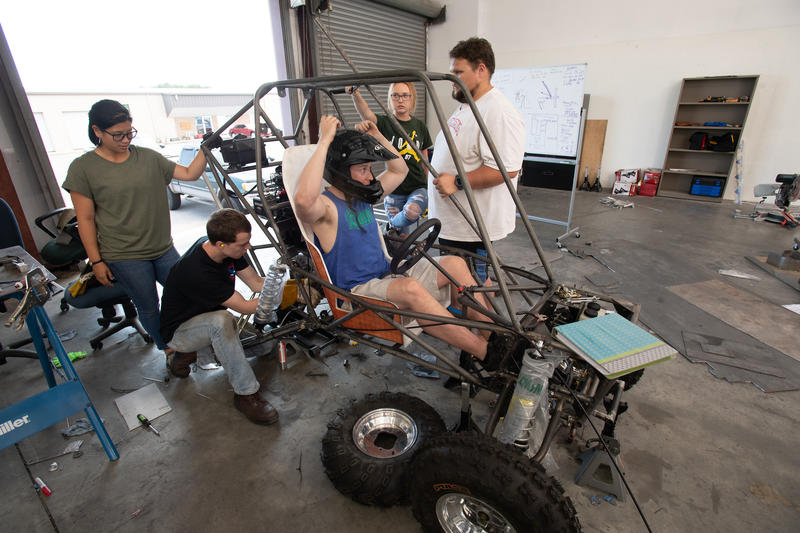 Steven Thornton tries out the drivers seat in the University of West Florida SAE Baja car their are building to compete at SAE Baja Kansas.