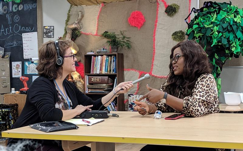 Sandra Averhart talks with GGAF 2018 Invited International Artist Abigail Nnaji Tuesday during her visit to the Creative Learning Academy.