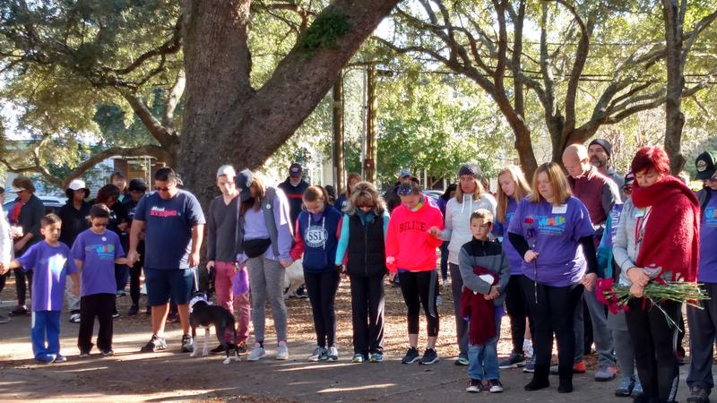 Participants in Covenant Care's 2018 Walk for Alzheimer's bow their heads as an Alzheimer's prayer is read.