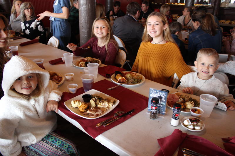 Kids enjoy their Thanksgiving meal at Harbor Docks.