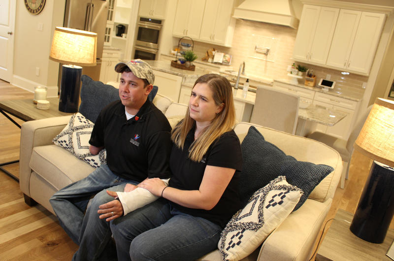 Retired Army Green Beret Staff Sgt. Bobby Dove sits with his wife, Mary-Elizabeth, in their new home.