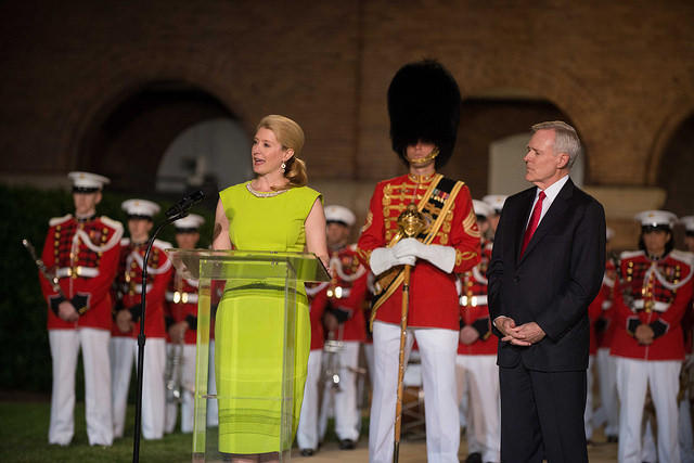 On May 30, 2014, Lynn Mabus, ship sponsor for the amphibious assault ship USS Tripoli (LHA 7), delivers remarks about what it means to be a part of the life of Tripoli as her husband, Secretary of the Navy (SECNAV) Ray Mabus looks on.