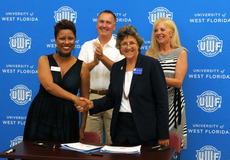 Dr. Judy Bense and Alicia Booker sign an agreement between UWF's Small Business Development Center and the Crestview Chamber of Commerce.