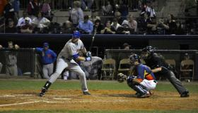 Racine-area native Jason Jaramillo wears his company's inner glove as he catches against the New York Mets.