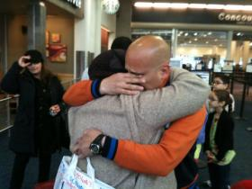 Iraqi family members embrace, after reuniting at General Mitchell International Airport. Some of the family members came here as refugees years ago; others just arrived this month.
