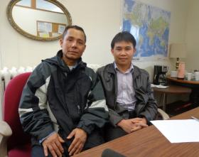 Nai Raw (left) is originally from Burma. He moved to Milwaukee as a refugee about three years ago. Catholic Charities caseworker Patrick Thein (right) translated for Raw during an interview.
