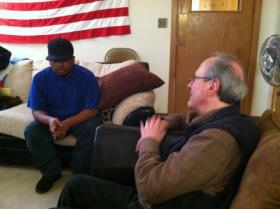 Client Manny Mora, Jr. speaks with Veteran Quest Director, Murray Bernstien.