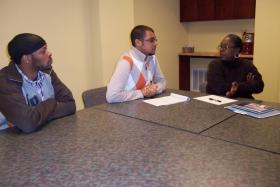 The ideas are coming from Christopher Allen (center) and two others participating in the session.