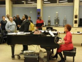 Arlene Skwierawski and K.C. Williams leading the MPS Alumni choir.
