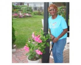 Marie Irby stands next to her favorite flowers.