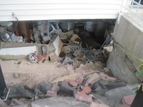 The inside of Irby's basement can be seen from the back yard, where part of the patio was engulfed as the foundation collapsed.