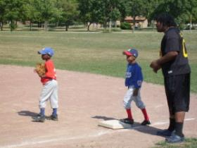 Kids play their final T-Ball game of the season on Milwaukee's north side.